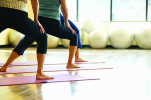 Caucasian prime adult females in yoga class.