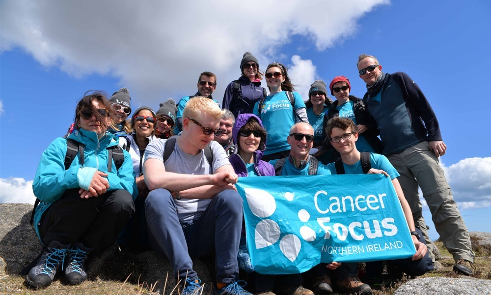 Forget Me Not group conquering Slieve Donard summit