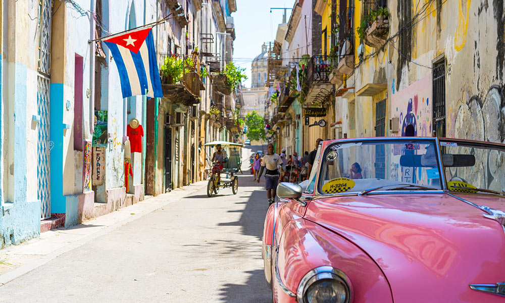 Cuban street featuring a pink car