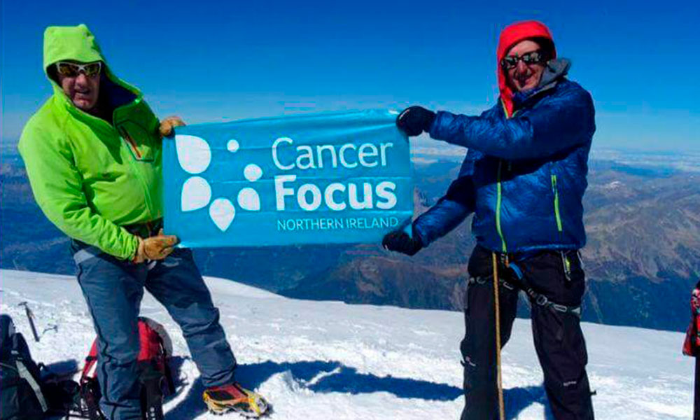 Cancer Focus fundraisers on mountain top