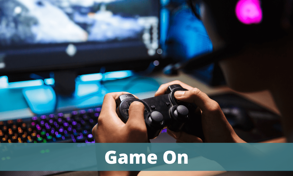 Game On - image of computer console being played in front of a computer screen