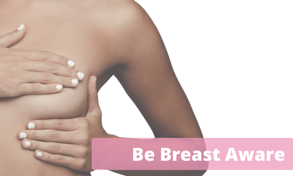 Woman showing how to be breast aware