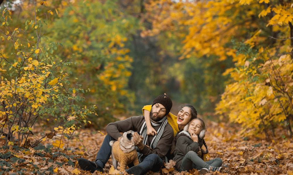 Family in wooded park with dog